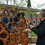 Sculptor Vaughn Randall and his assistant, Erin Schiano, came to Clarksville in April to assemble the cast iron sculpture at Downtown Commons.